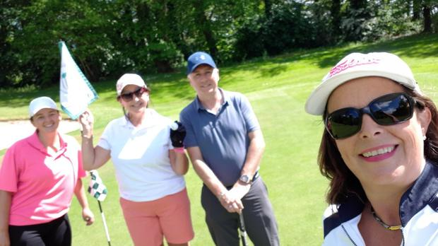 Celebration time: (l-r) Charlotte Diana Boote, Kathleen Butler, Finbar Hagarty and Charlotte Boote celebrate hole in one number two at Gowran Park