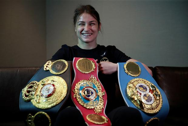 Katie Taylor poses with her IBF, WBO and WBA belts at yesterday's press conference in New York. Photo: Action Images via Reuters/Andrew Couldridge