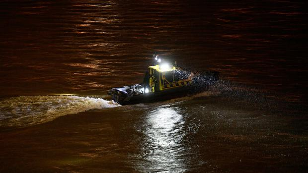 A rescue boat searches of victims after a tourist boat crashed with another ship late Wednesday, May 29, 2019. (Zsolt Szigetvary/MTI via AP)