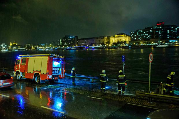 Rescuers search for victims on the river bank early Thursday, May 30, 2019 after a tourist boat crashed with a river cruise boat, overturned and sank in River Danube in Budapest, Hungary, late Wednesday, May 29, 2019. (Peter Lakatos/MTI via AP)