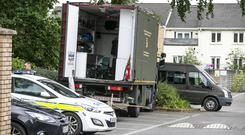 Gardai and Army personnel searching an area on Waterville Road, Blanchardstown.