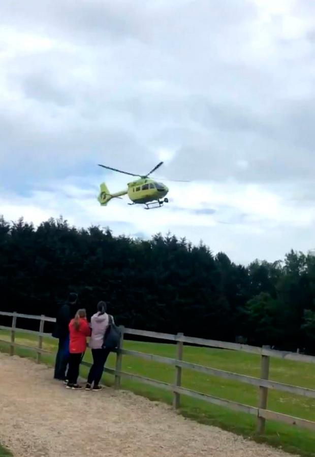 An air ambulance helicopter near Lightwater Valley theme park in North Yorkshire Photo credit: Emma Rowland/PA Wire