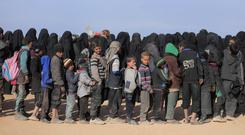 Aid queue: Many in the war-ravaged population of Syria rely on food handouts from foreign agencies such as this one in Baghouz earlier this year. Photo: Reuters
