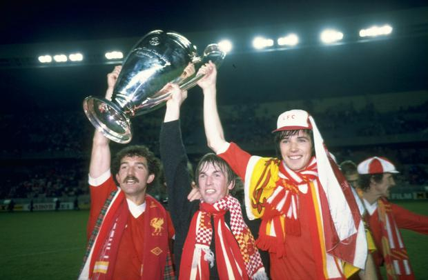 Graeme Souness (left) Kenny Dalglish (centre) and Alan Hansen (right) the three Scottish players for Liverpool hold up the European Cup after beating Real Madrid in the European Cup final in Paris on May 27 1981.