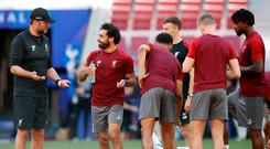 Liverpool manager Jurgen Klopp (left) and Mohamed Salah during a training session at the Wanda Metropolitano, Madrid. Photo: Martin Rickett/PA Wire