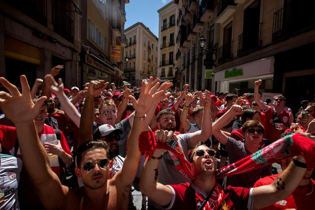 Liverpool fans chant as they march in downtown Madrid, Spain ahead of the Champions League final. Photo: AP Photo/Emilio Morenatti