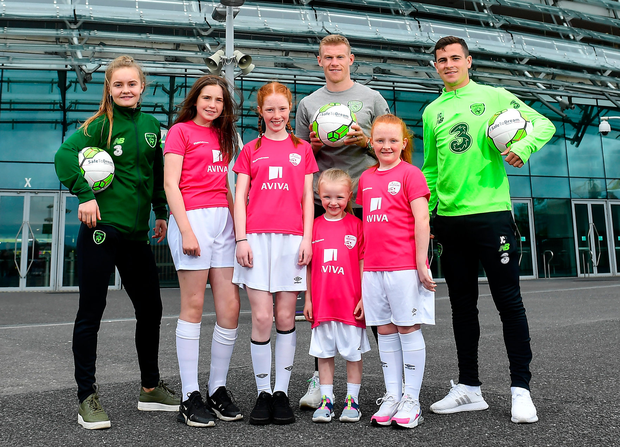 Republic of Ireland Internationals Izzy Atkinson, James McClean and Josh Cullen along with (l-r) Anna Dowling-Gavigan, aged 12, from Clonee; Alannah Ferrari (11) age 11, from Ringsend and sisters Quinn (6) and Eden Murphy (9) from Ringsend, Co Dublin at the Aviva Soccer Sisters Dream Camp. Photo: Sportsfile