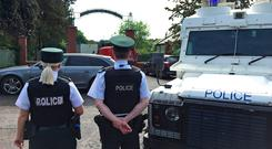 Police and army bomb disposal experts at Shandon Park Golf Club in east Belfast to examine a suspect device under a car in the car park. A special tournament being held at the Shandon Park club was cancelled and at least 70 people evacuated. David Young/PA Wire