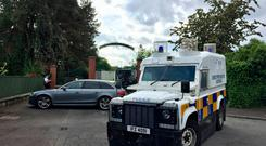 Police and army bomb disposal experts at Shandon Park Golf Club in east Belfast to examine a suspect device under a car in the car park. A special tournament being held at the Shandon Park club was cancelled and at least 70 people evacuated. Saturday June 1, 2019. : David Young/PA Wire