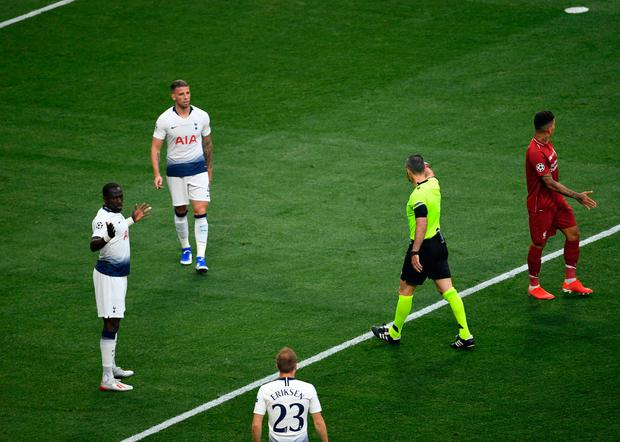 Tottenham Hotspur's Moussa Sissoko (left) concedes a penalty resulting in the opening goal scored by Liverpool's Mohamed Salah during the UEFA Champions League Final at the Wanda Metropolitano, Madrid.