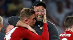 Liverpool manager Juergen Klopp celebrates with Jordan Henderson after winning the Champions League. Photo: Reuters/Kai Pfaffenbach