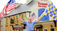 ON A WAVE: Tommy Tubridy on Doonbeg's main street ahead of the visit of president Donald Trump. Picture: Gerry Mooney