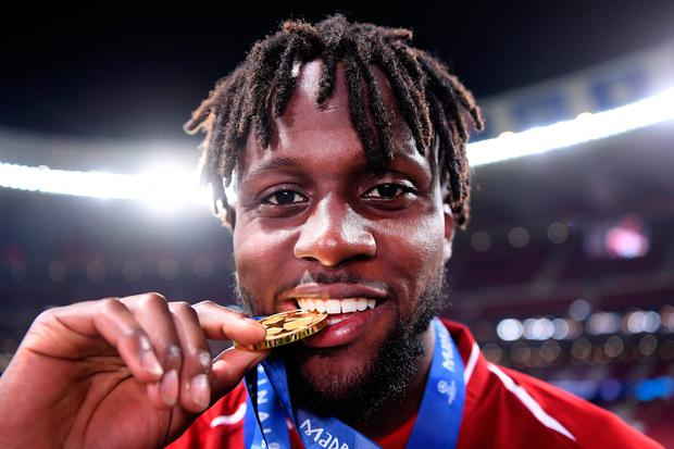 Divock Origi of Liverpool celebrates with his medal after winning the Champions League final. Photo: Laurence Griffiths/Getty Images