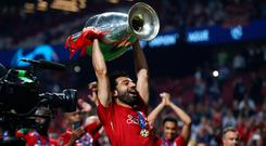 Mohamed Salah lifts the Champions League Trophy. Photo: Clive Rose/Getty Images