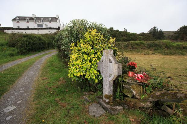 The place where Sophie was murdered in west Cork which is marked with a cross and floral tributes. Photo: Mark Condren