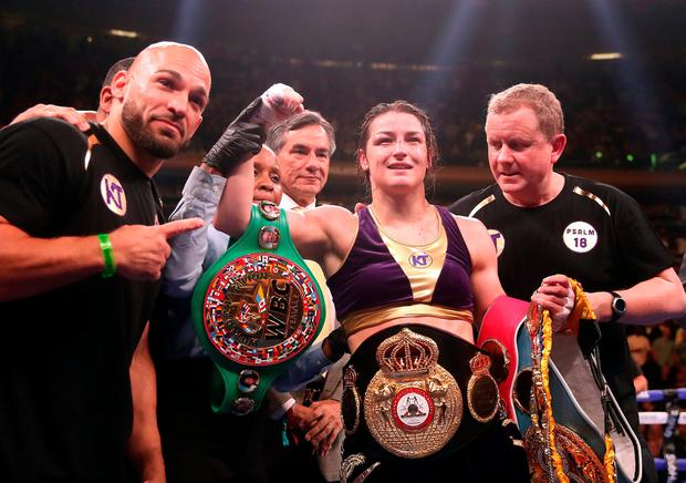 Katie Taylor (centre) celebrates her win against Delfine Persoon in the IBF, WBC, WBO, WBA, Ring Magazine Women's Lightweight World Championships fight at Madison Square Garden, New York. Photo credit: Nick Potts/PA Wire