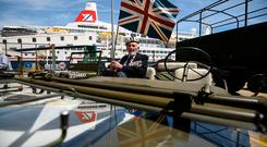 Veteran John Roberts, 95, from Whitstable, on a jeep as he arrives to the cruise termianl to board the MV Boudicca (behind) ahead of its departure from the port of Dover in Kent, on day one of a trip arranged by the Royal British Legion for D-Day veterans to mark the 75th anniversary of D-Day. Kirsty O'Connor/PA Wire