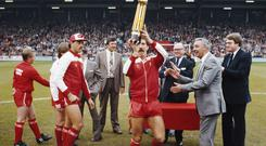 Liverpool manager Joe Fagan (2nd r) applauds as captain Graeme Souness lifts the First Division Trophy for the 1983/84 season at Anfield before they went on to beat Roma in the European Cup final. (Photo by Mike Powell/Allsport/Getty Images)