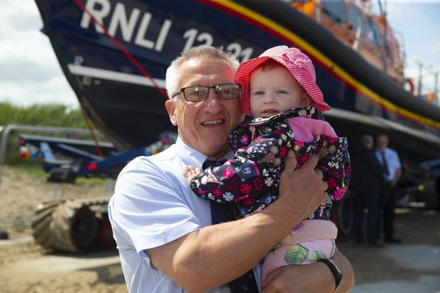 The RNLI's latest lifeboat arrives at Clogherhead, County Louth. . Pictured is the lifeboats Mechanic Padraig Rath with his granddaughter Anna Browne. Picture: Patrick Browne