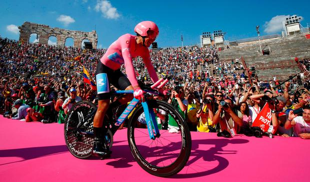 Overall race winner Team Movistar rider Ecuador's Richard Carapaz reacts as he enters the arena after competing in stage 21, the final stage of the 102nd Giro d'Italia. Photo: Luk Benies/Getty Images