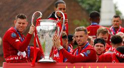 Liverpool's James Milner and Jordan Henderson with the trophy during the parade. Photo: REUTERS/Phil Noble