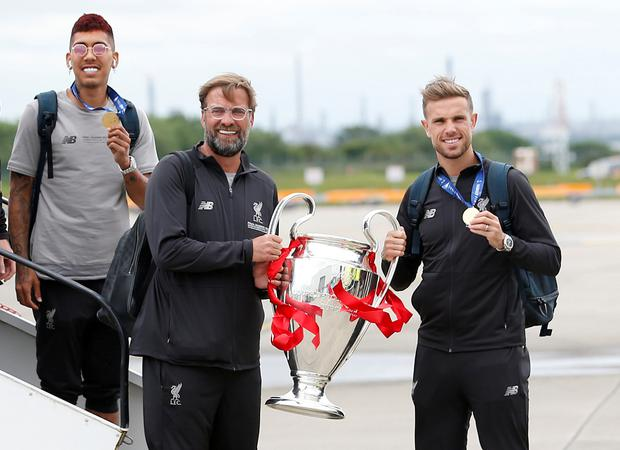 Liverpool's Jordan Henderson and manager Juergen Klopp pose on the runway with the trophy as they arrive back in Liverpool after winning the Champions League final . Photo: Action Images via Reuters/Craig Brough