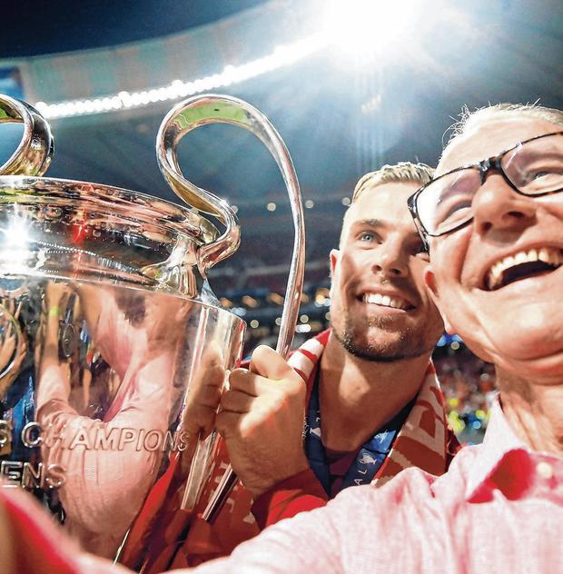 Liverpool captain Jordan Henderson with his father, Brian, and the European Cup after the victory against Spurs. Photo: Carl Recine/Reuters