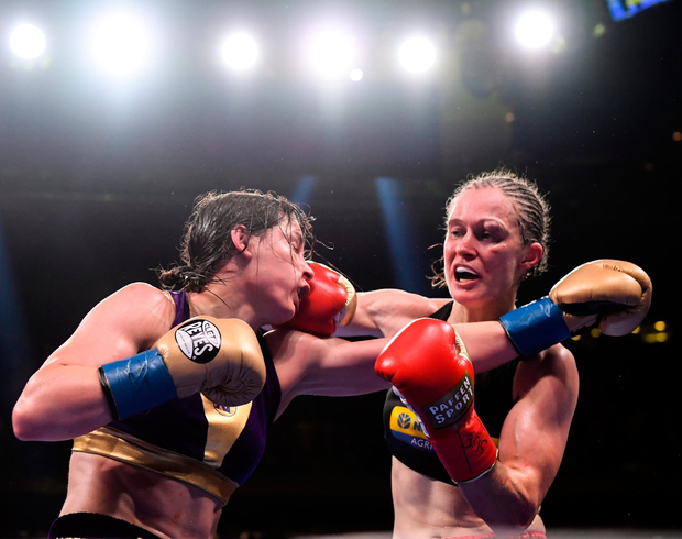 Katie Taylor and Delfine Persoon exchange punches during their Undisputed Female World Lightweight Championship fight at Madison Square Garden in New York. Photo: Stephen McCarthy/Sportsfile