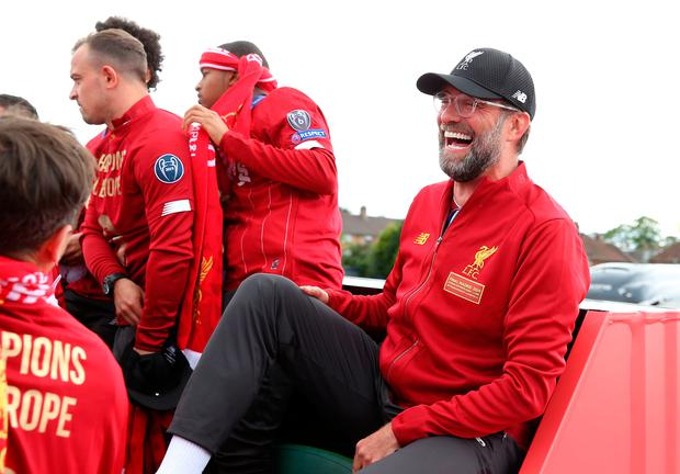 Liverpool manager Jurgen Klopp on an open top bus during the Champions League winners parade in Liverpool. Photo: Barrington Coombs/PA Wire
