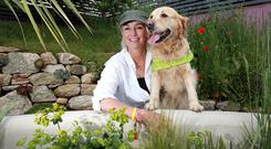 Top dog: Garden designer Gráinne Walsh with Farah at Bloom in the Phoenix Park. Photo: Frank McGrath