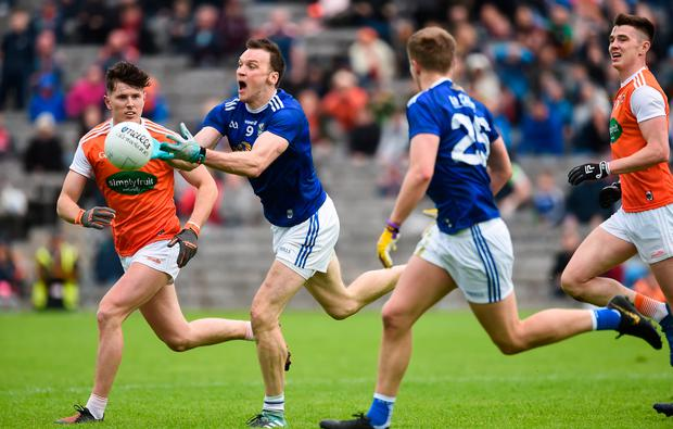 Gearoid McKiernan of Cavan in action against Joe McElroy of Armagh during the Ulster SFC semi-final at St Tiernach's Park in Clones, Monaghan. Photo: Oliver McVeigh/Sportsfile