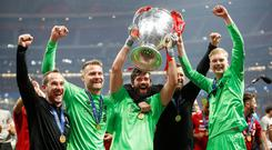 Goalkeepers' union: Ireland U-21 goalkeeper Caoimhin Kelleher with his Liverpool team-mates Simon Mignolet and Allison (C) celebrating with the Champions League trophy in Madrid on Saturday night. Photo: REUTERS/Carl Recine