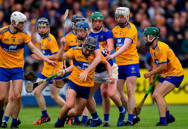 Sean Ronan of Clare in action against Matthew Power of Tipperary. Photo: Piaras Ó Mídheach/Sportsfile