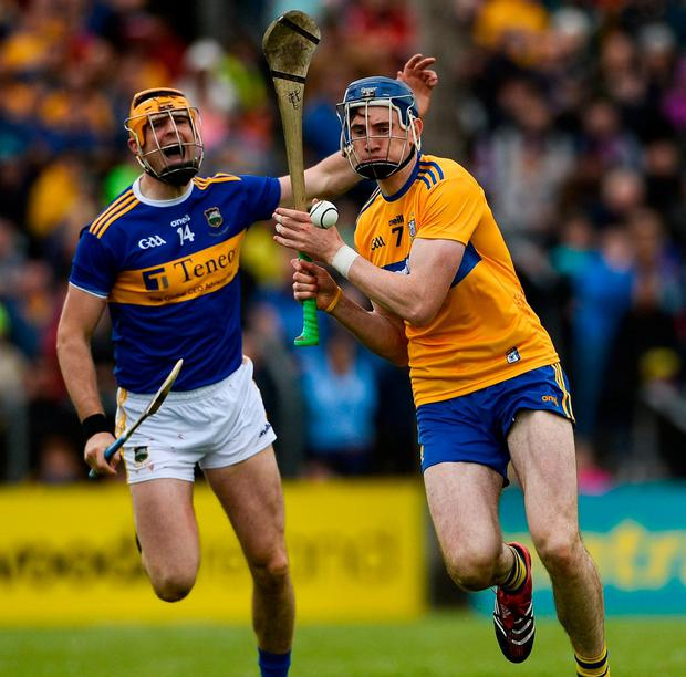 David Fitzgerald of Clare in action against Séamus Callanan of Tipperary. Photo: Diarmuid Greene/Sportsfile