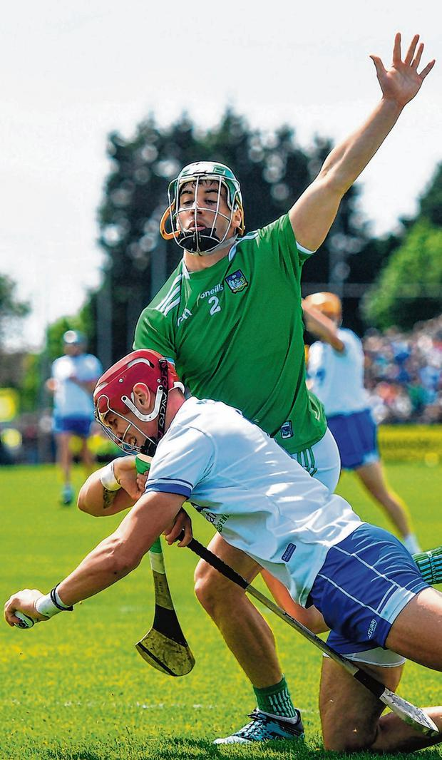 Waterford's Maurice Shanahan gets in a tangle with Limerick's Sean Finn at Walsh Park yesterday. Photo: Ramsey Cardy/Sportsfile
