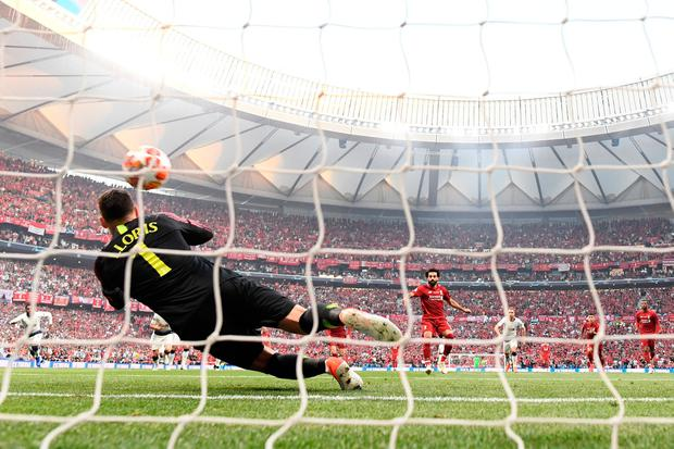 Mohamed Salah scores a penalty to give Liverpool an early lead. Photo: Matthias Hangst/Getty Images