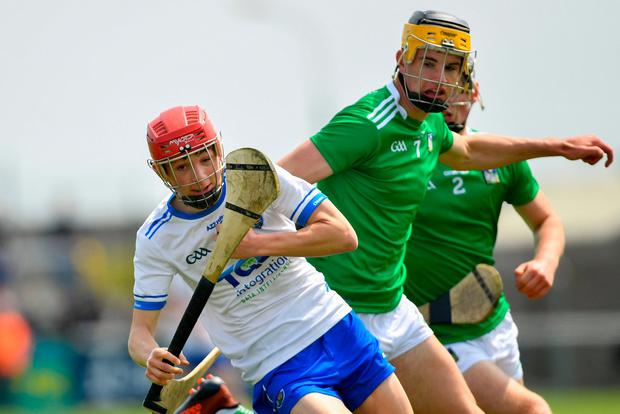 Jake Foley of Waterford in action against Colin Coughlan, left, and Ronan Lyons of Limerick. Photo: Ramsey Cardy/Sportsfile