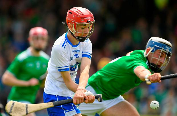 Jake Foley of Waterford in action against Ethan Hurley of Limerick. Photo: Ramsey Cardy/Sportsfile