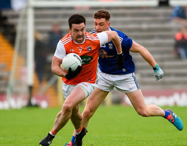 Aidan Forker of Armagh in action against Ciaran Brady of Cavan. Photo: Oliver McVeigh/Sportsfile