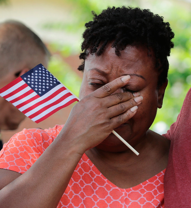 Emotion: A co-worker of one of the victims cries at a memorial in Virginia Beach. Photo: Chip Somodevilla/Getty Images