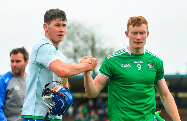 Conor Prunty of Waterford shakes hands with William O'Donoghue of Limerick