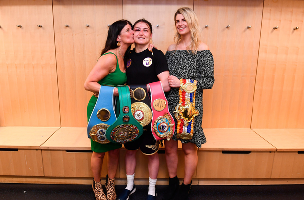 Katie Taylor celebrates with her mother Bridget and sister Sarah