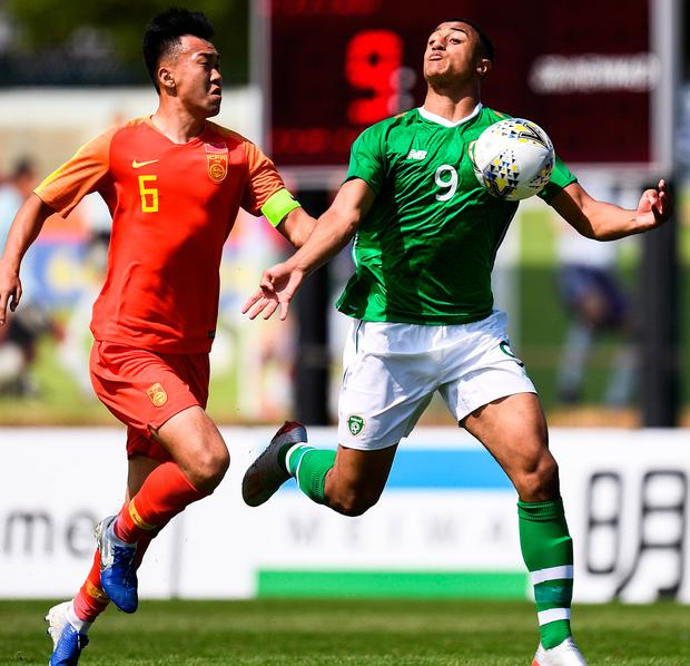 Ireland's Adam Idah in action against Wei Wu of China at Stade de Lattre de Tassigny in Aubagne, France. Photo: Alexandre Dimou/Sportsfile