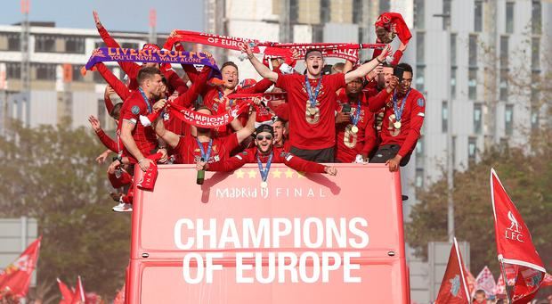 Liverpool's Adam Lallana (centre) on the bus during the Champions League winners parade in Liverpool. Photo: Barrington Coombs/PA Wire