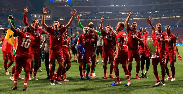 Liverpool players celebrate with the trophy after winning the Champions League final at the Wanda Metropolitano, Madrid last Saturday. Photo: Peter Byrne/PA Wire