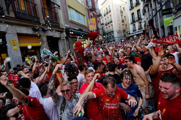Liverpool fans celebrate in Madrid. Photo: Reuters/Juan Medina