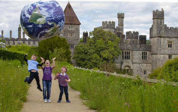 Whole world in their hands: Joe McCabe, Adam Toomey and Alyssa Ferguson, all aged seven, in Lismore Castle Gardens. Photo: Patrick Browne