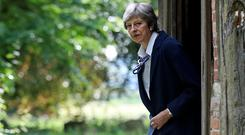 Stepping down: British Prime Minister Theresa May's departure means more Brexit uncertainty. Photo: REUTERS/Simon Dawson
