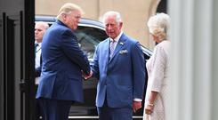 Hand of friendship: Mr Trump meets Prince Charles ahead of tea at Clarence House. Photo: REUTERS