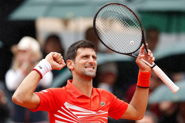 Serbia's Novak Djokovic celebrates winning his fourth round match of the French Open tennis tournament against Germany's Jan-Lennard Struff. Photo: AP Photo/Christophe Ena